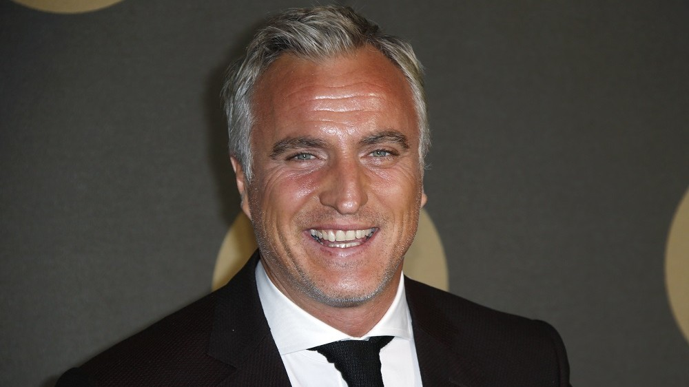 French ex-football player David Ginola poses during a photocall upon his arrival for the 30th anniversary party of private television channel Canal Plus, on November 4, 2014 at the Palais de Tokyo in Paris. AFP PHOTO / KENZO TRIBOUILLARD