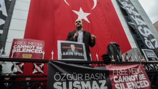 Tarik Toros, director general of Bugun TV, delivers a speech outside its headquarters in Istanbul during a protest against the Turkish government's crackdown on media outlets on October 27, 2015. There has been growing concern about deteriorating press freedoms under Turkish President Recep Tayyip Erdogan, in particular over the numbers of journalists facing legal proceedings on accusations of insulting top officials. AFP PHOTO / OZAN KOSE