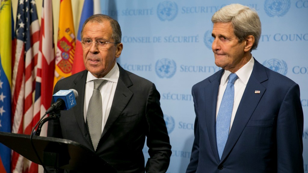 """US Secretary of State John Kerry (R) and Russia Foreign Minister Sergey Lavrov speak to the media after a meeting concerning Syria at the United Nations headquarters in New York on September 30, 2015. Russia's air strikes in Syria targeted opposition forces and not Islamic State jihadists, a US defense official said, contradicting Russian claims. At the United Nations in New York, Secretary of State John Kerry made clear that Washington would have """"grave concerns"""" should Moscow opt to strike targets in areas where IS fighters and Al-Qaeda-linked groups are not operating. AFP PHOTO/Dominick Reuter"""
