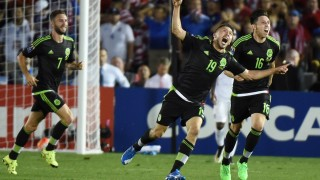 Oribe Peralta of Mexico (C) celebrates with teammates after scoring a goal during their 2015 CONCACAF Cup match against the USA at the Rose Bowl in Pasadena, California on October 10, 2015. The match is a playoff for the 2017 Confederations Cup. The United States lost to Mexico 3-2. AFP PHOTO / MARK RALSTON