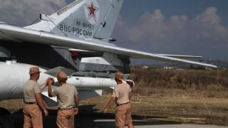 2712069 10/04/2015 Russian servicemen attach a Kh-25 high-precision missile to a Su-24 aircraft at the Khmeimim airbase in Syria. Dmitriy Vinogradov/RIA Novosti