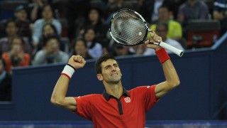 Novak Djokovic of Serbia reacts after defeating Jo-Wilfried Tsonga of France in their final match of the men's singles during the 2015 Shanghai Rolex Masters tennis tournament in Shanghai, China, 18 October 2015.  Novak Djokovic of Serbia defeated Jo-Wilfried Tsonga of France 2-0 (6-2/6-4) in their final match of the men's singles during the 2015 Shanghai Rolex Masters tennis tournament in Shanghai, China, 18 October 2015.