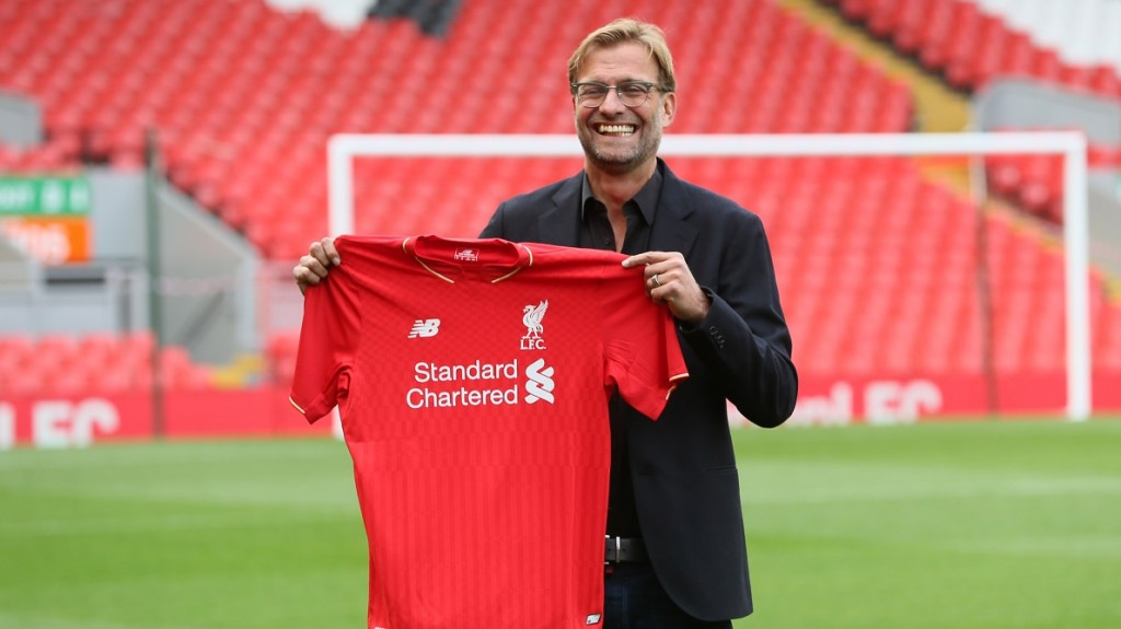 New Liverpool manager Juergen Klopp poses with shirt during is presentation to the media at a press conference on October 9, 2015 at Anfield in Liverpool, England. Photo Paul Currie / Backpage Images / DPPI