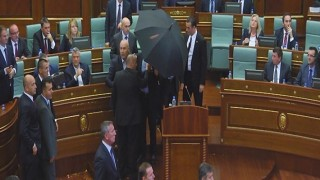 PRISTINA, KOSOVO - SEPTEMBER 22 :  A frame grab taken from AA footage shows opposition MPs throwing eggs at Kosovo's Prime Minister Isa Mustafa during his speech at parliament in Pristina, Kosovo on September 22, 2015. Erkin Keci / Anadolu Agency