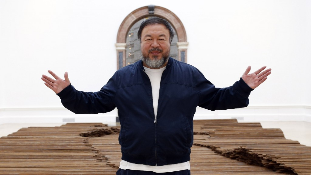 LONDON, UNITED KINGDOM - SEPTEMBER 15:  Ai Weiwei stands with his sculpture 'Straight' as he previews works from His landmark art exhibition on September 15, 2015 in London, England. The Royal Academy of Art is showing the work of one of China's leading contemporary artists until mid-December. Ai Weiwei's activism in China saw him detained without charge in 2011 for 81 days. (Photo by Alex B. Huckle/Getty Images)