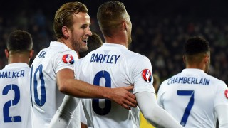 England's Harry Kane reacts after scoring a goal with teammate Ross Barkley during the Euro 2016 Group E qualifying football match between Lithuania and England at LFF stadium in Vilnius on October 12, 2015. AFP PHOTO / JANEK SKARZYNSKI