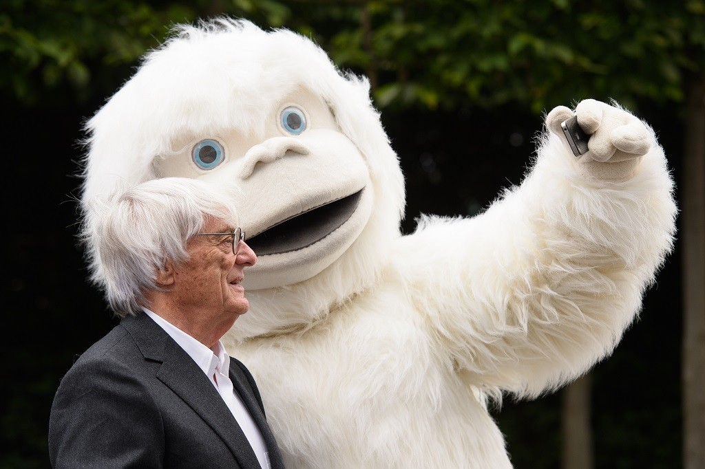 """Formula One Group Chief Executive Bernie Ecclestone stands next to a man in a Yeti costume as he attends a photocall to launch the """"Lost Yeti Hunters"""" Mongol rally team in London on16 July, 2015. The team will race the 10,000 miles from London to Ulan Bator, Mongolia with the hope of raising money for the Cool Earth, Rett Syndrome Foundation UK and SOS Children charities.  AFP PHOTO/Leon Neal"""