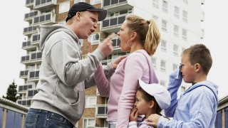 Family fighting outdoors