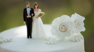 Close-up of figurine couple on wedding cake