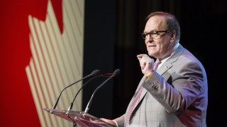 TORONTO, ON - APRIL 29  - Marcel Aubut, President, Canadian Olympic Committee, talks to the audience during the unveiling of new Pan Am and Parapan Am uniforms.