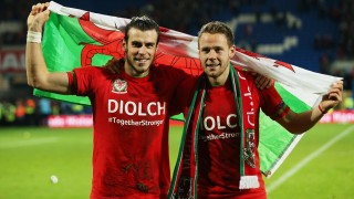 Gareth Bale and Chris Gunter celebrate after the UEFA Euro 2016 qualifying match between Wales and Andorra played at The Cardiff City Stadium, Cardiff, October 13 2015 . Photo James Marsh / BPI / DPPI