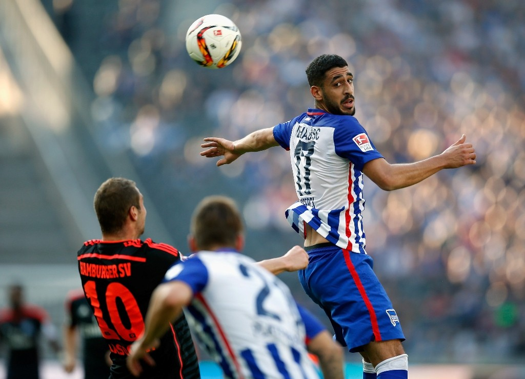 xxx (L) of Berlin is challenged by yyy of Hamburger SV during the Bundesliga match between Hertha BSC and Hamburger SV at Olympiastadion on October 3, 2015 in Berlin, Germany.