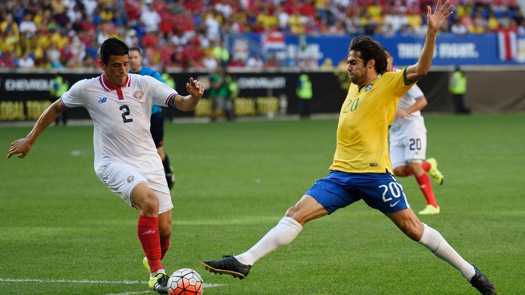 Brazil's Kaka (R) controls the ball in front of Costa Rica's Johnny Acosta during the friendly match between Brazil and Costa Rica September 5, 2015 at Red Bulls Arena in Harrison, New Jersey. AFP PHOTO/DON EMMERT