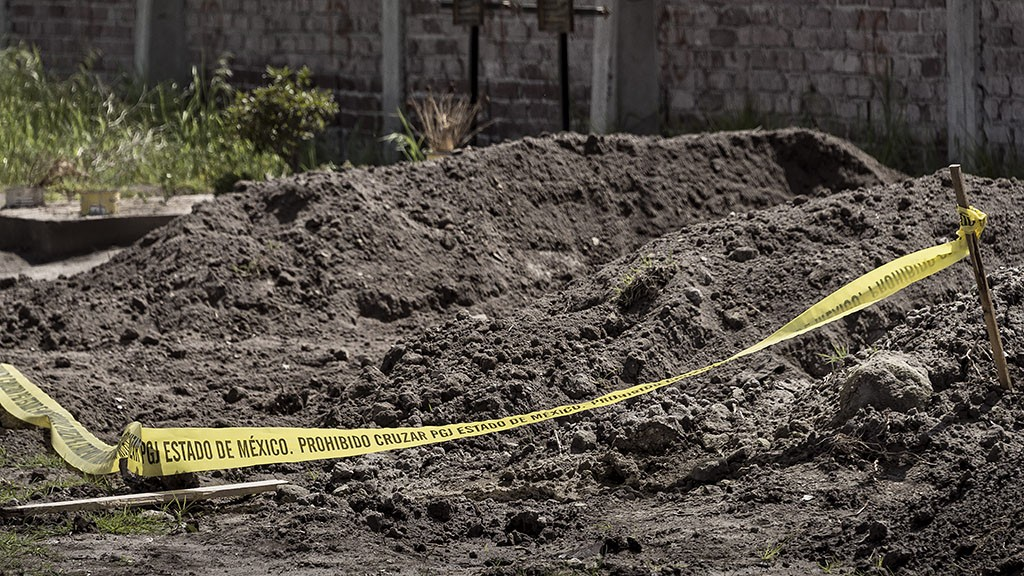 View of a mass grave at the cemetery in Nextlalpan, Mexico state on June 19, 2015, where the corpse of 18-year-old daughter Mariana Gonzalez could be buried. The murders of women perpetrated by men were established in Mexico as femicides in 2011, but relatives of victims believe that the rigid constraints of the law leave out innumerable crimes. AFP PHOTO/OMAR TORRES