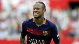 Barcelona's Brazilian forward Neymar grimaces during the Spanish league football match Sevilla FC vs Barcelona at the Ramon Sanchez Pizjuan stadium in Sevilla on October 3, 2015.   AFP PHOTO/ CRISTINA QUICLER