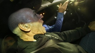 """Santiago Arrospide aka """"Santi Potros"""" leaves the Villena prison in a car after being released in Villena, near Alicante, on December 4, 2014. A Spanish court ordered the release of two jailed members of Basque armed separatist group ETA, including an ex-leader of the group, after reducing their sentence by the time they spent in custody abroad. """"Santi Potros"""" was convicted for his involvement in the car bombing at the Hipercor supermarket parking lot in Barcelona, which killed 21 people on June 19, 1987.  AFP PHOTO / MANUEL LORENZO"""
