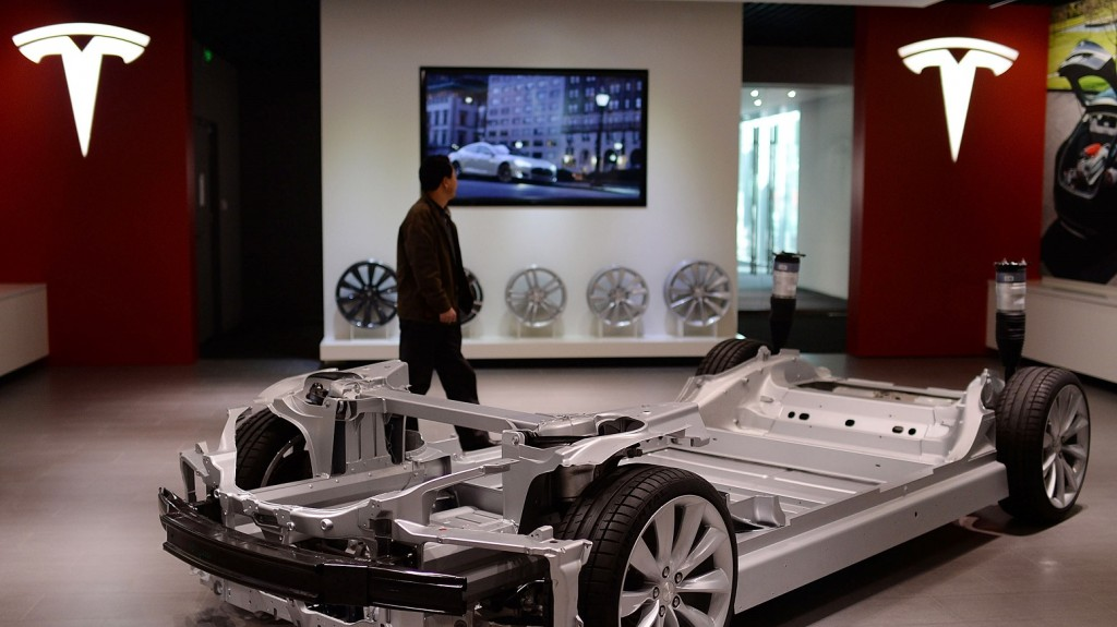 BEIJING, CHINA - NOVEMBER 03:  (CHINA OUT) A man walks past the chassis of a Model S sedan on display in the Tesla showroom at Parkview Green Shopping Mall on November 3, 2013 in Beijing, China. Electric-car maker Tesla opened its first store in Beijing on Saturday.  (Photo by ChinaFotoPress/ChinaFotoPress via Getty Images)