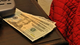 money on the bed