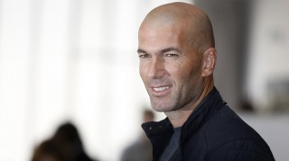 French former football player Zinedine Zidane poses during a photo call for fashion brand Mango in Paris, on October 5, 2015. Zidane is the face of the new men's collection. AFP PHOTO / FLORIAN DAVID