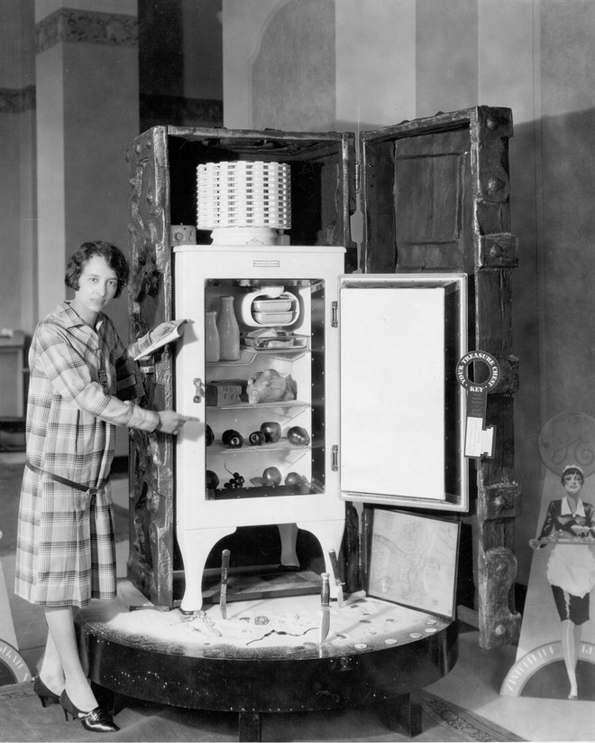 """Unveiling of new model of General Electric Monitor-top refrigerator with the opening of a treasure chest containing the new refrigerator. """"Making it safe to be hungry"""" with Type G-40 all-steel GE electric refrigerator.  Opening the treasure chest, March 22, 1929, GE Refrigerator Agency, Erie, Pennsylvania."""