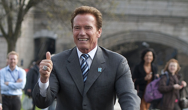 Hollywood star Arnold Schwarzenegger rides a London Cycle Hire Scheme bicycle during a photocall with London Mayor Boris Johnson, in London, on March 31, 2011. Schwarzenegger met Johnson Friday to exchange ideas on how to drive forward markets for low and zero emission technologies. AFP PHOTO/Ki Price (Photo credit should read Ki Price/AFP/Getty Images)