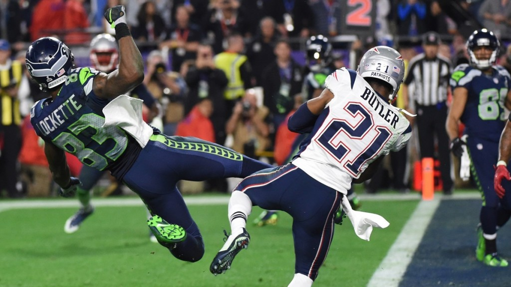 Malcolm Butler (R) of the New England Patriots intercepts a pass intended for Ricardo Lockette (L) of the Seattle Seahawks late in the fourth quarter of Super Bowl XLIX  on February 1, 2015 at University of Phoenix Stadium in Glendale, Arizona. The New England Patriots defeated the Seattle Seahawks 28-24.       AFP PHOTO /  TIMOTHY  A. CLARY