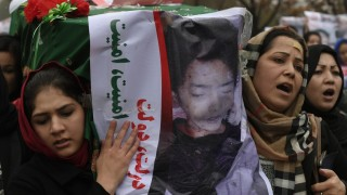 Afghan protesters carry a coffin containing a decapitated body of one of seven Shiite Muslim Hazaras, including four men, two women and one child, during a demonstration in Kabul on November 11, 2015. Thousands of protesters marched coffins containing the decapitated bodies of seven Shiite Hazaras through the Afghan capital Kabul on November 11 to demand justice for the gruesome beheadings, which prompted fears of sectarian bloodshed in the war-torn country. Demonstrators gathered in the rain in west Kabul and marched towards the city centre, chanting death slogans to the Taliban and the Islamic State group while demanding justice and protection from the government. AFP PHOTO / SHAH Marai