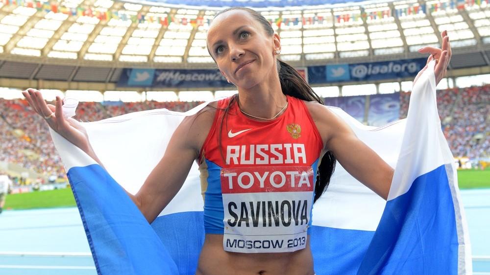 Russia's Mariya Savinova celebrates after winning silver medal during the women's 800 metres final at the 2013 IAAF World Championships at the Luzhniki stadium in Moscow on August 18, 2013.       AFP PHOTO / KIRILL KUDRYAVTSEV