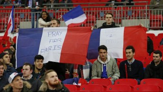 France fans hold up French flags before the start of the friendly football match between England and France at Wembley Stadium in west London on November 17, 2015.  AFP PHOTO / IAN KINGTON NOT FOR MARKETING OR ADVERTISING USE / RESTRICTED TO EDITORIAL USE
