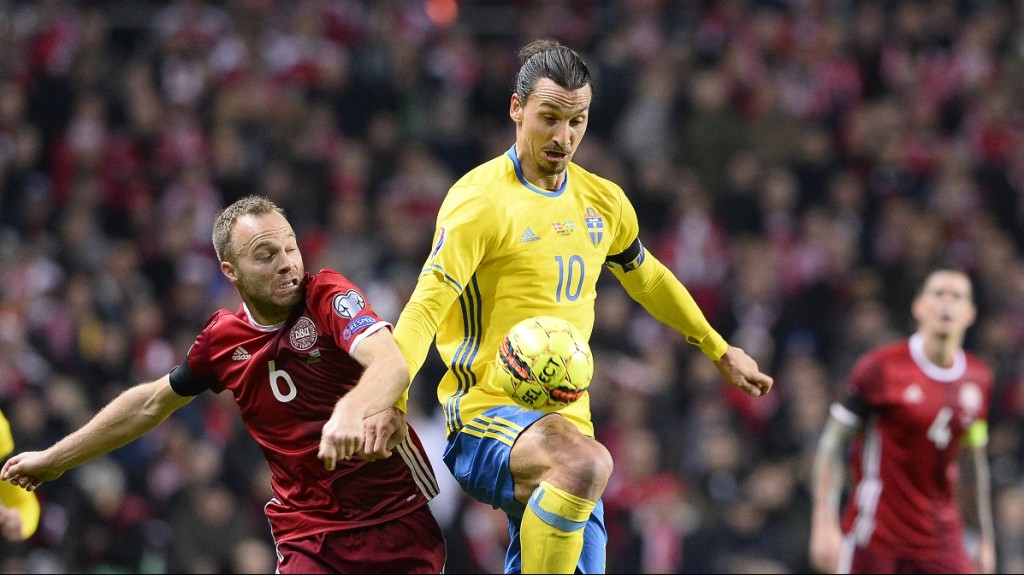 Sweden's forward and team captain Zlatan Ibrahimovic vies with Denmark's defender Lars Jacobsen (L) during the Euro 2016 second leg play-off football match between Denmark and Sweden at Parken stadium in Copenhagen on November 17, 2015. AFP PHOTO / JONATHAN NACKSTRAND