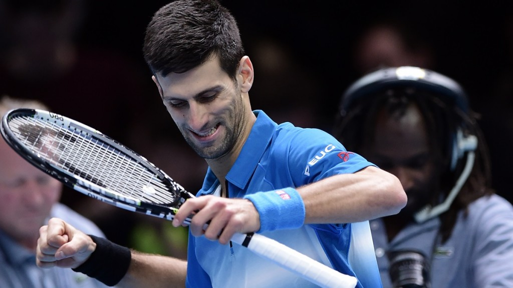 Serbia's Novak Djokovic celebrates after beating Spain's Rafael Nadal in the men's singles semi-final match on day seven of the ATP World Tour Finals tennis tournament in London on November 21, 2015. Djokovic won 6-3, 6-3.  AFP PHOTO / LEON NEAL / AFP / LEON NEAL