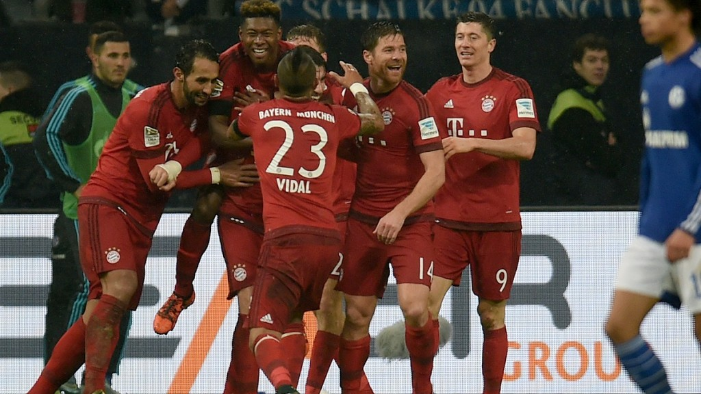 Bayern Munich's Spanish midfielder Javier Martinez (C, hidden) celebrates with his teammates after scoring the 1-2 during the German first division Bundesliga football match FC Schalke 04 vs FC Bayern Munich in Gelsenkirchen, western Germany, on November 21, 2015.  AFP PHOTO / PATRIK STOLLARZ  RESTRICTIONS: DURING MATCH TIME: DFL RULES TO LIMIT THE ONLINE USAGE TO 15 PICTURES PER MATCH AND FORBID IMAGE SEQUENCES TO SIMULATE VIDEO.  ==RESTRICTED TO EDITORIAL USE == FOR FURTHER QUERIES PLEASE CONTACT THE DFL DIRECTLY AT + 49 69 650050. / AFP / PATRIK STOLLARZ