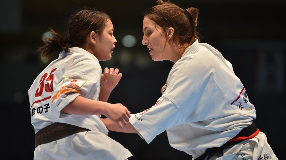 Hungary's Csenge Szepesi (R) and Japan's Juri Minamihara (L) fight during the women's final match of the 11th World Karate Championship in Tokyo on November 1, 2015. Szepesi won the match.     AFP PHOTO / KAZUHIRO NOGI