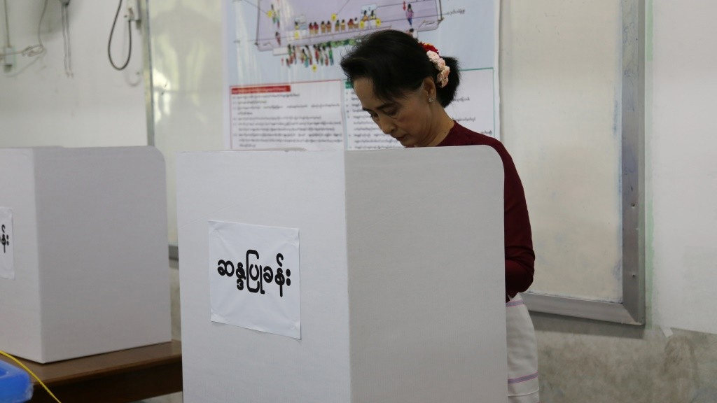 In this photograph taken on November 8, 2015, Myanmar opposition leader Aung San Suu Kyi and head of the National League for Democracy (NLD) party fills out her ballot at a polling center in Yangon. Myanmar's powerful army chief has congratulated Aung San Suu Kyi's opposition party for winning a majority in the country's historic general election, in a statement released late November 11, 2015 on the military's official Facebook page. AFP PHOTO / STR