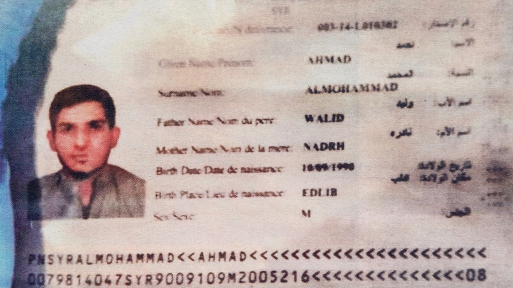 A photo taken in Belgrade on November 15, 2015 shows the frontpage of Serbian magazine Blic, displaying a Syrian passport found by police at the scene of one of the Paris attacks. The passport was issued to Ahmad alMohammad, an asylum seeker who had taken the migrants' route through the Balkans, Greece's migration minister said on November 15. AFP PHOTO / ANDREJ ISAKOVIC