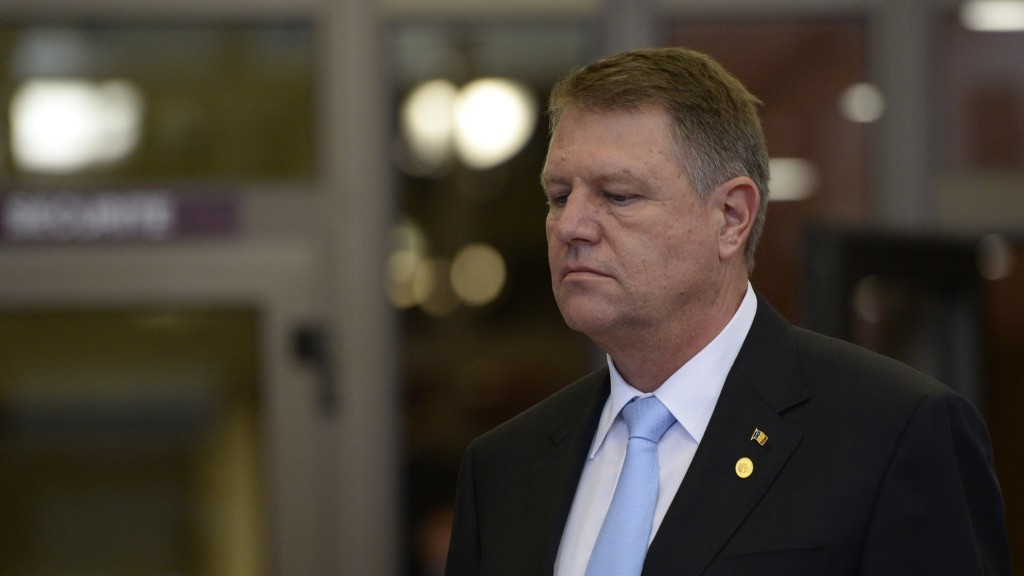 Romanian President  Klaus Werner Iohannis leaves after an European Council leaders' summit, at the European Council in Brussels, on October 15, 2015. AFP PHOTO/Thierry Charlier