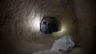 Inside a small-scale Tanzanite mine in Tanzania miners are working under harsh conditions. Tanzanite is the blue variety of the mineral Zoisite. It is a very rare gemstone and noted for its trichroism, appearing alternately sapphire blue, violet and burgun