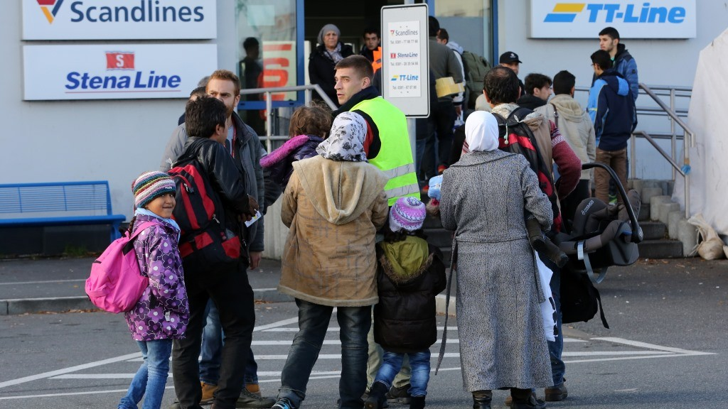 Arriving transit refugees go to the ferry center in order to purchase tickets for passage to Sweden in the seaport of Rostock,Germany, 12 November 2015. Due to the large number of refugees, Sweden has temporarily reintroduced passport control at the border. The sanction will initially be limited to ten days. Photo:BERNDWUESTNECK/dpa