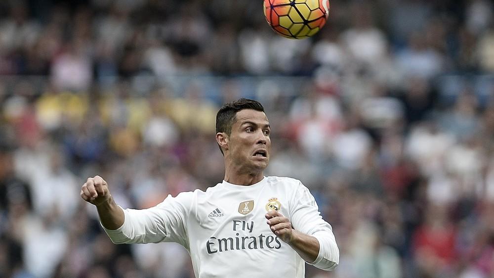 MADRID, SPAIN - OCTOBER 31: Cristiano Ronaldo (C) of Real Madrid is in action during a La Liga soccer match between Real Madrid and Las Palmas at Santiago Bernabeu Stadium in Madrid, Spain on October 31, 2015. Burak Akbulut / Anadolu Agency