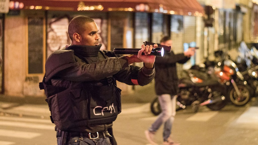 FRANCE, Paris: Police officers are seen in the 11th district of Paris  after an attack on November 13, 2015 in Paris, France. According to reports, over 150 people were killed in a series of bombings and shootings across Paris, including at a soccer game at the Stade de France and a concert at the Bataclan theater.  - CITIZENSIDE/DAVID JULI¿