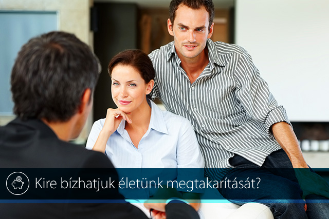 A young couple consulting a financial planner at home