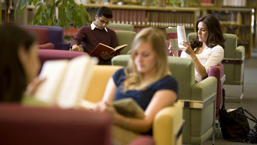 Young adults reading in library