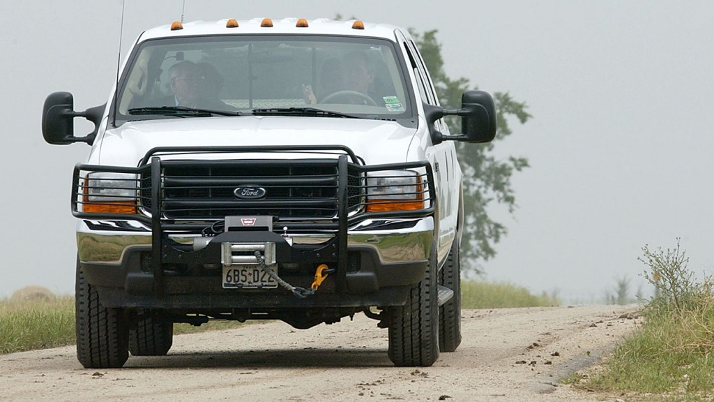 US President George W. Bush (R) drives a Ford F350 pickup truck with Australia's Prime Minister John Howard (L) to their joint press conference at Bush's ranch 03 May 2003 in Crawford, Texas. Bush is hosting Howard on his 1,600-acre ranch in Crawford, Texas.   AFP PHOTO/Stephen JAFFE / AFP / STEPHEN JAFFE