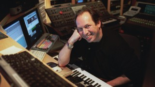 """ADVANCE FOR WEEKEND EDITIONS, MARCH 15-18--  Oscar-winning composer Hans Zimmer poses at the keyboard in his Santa Monica, Calif. studio March 6, 2001. The music he wrote for """"Gladiator"""" has so-far produced two best-selling CDs and earned Zimmer his seventh Oscar nomination. (AP Photo/Rene Macura)"""