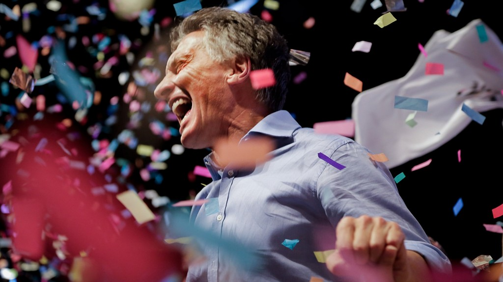 """Photo released by Cambiemos press office of the Head of Government of the Autonomous City of Buenos Aires and candidate for the Cambiemos (Let's Change) party, Mauricio Macri celebrating at the Cambiemos (Let's Change) party headquarters in Buenos Aires on November 22, 2015, after getting early results of the presidential run-off election in Argentina. Argentina's conservative president-elect Mauricio Macri promised a """"marvelous"""" new era was starting for the country after he won a runoff election on Sunday. AFP PHOTO/ Cambiemos / AFP / CAMBIEMOS / HO"""