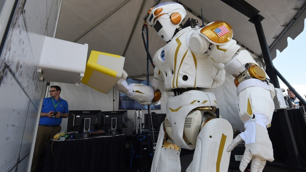 The humanoid robot named 'Valkyrie' designed by NASA is on display during the finals of the DARPA Robotics Challenge at the Fairplex complex in Pomona, California on June 5, 2015.  The competition has 24 teams vying to develop robots capable of assisting humans in responding to natural and man-made disasters.      AFP PHOTO/MARK RALSTON / AFP / MARK RALSTON