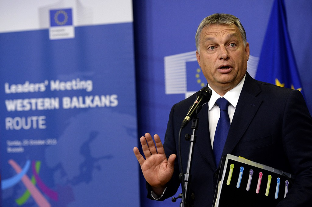 Hungarian Prime Minister Viktor Orban holds a press conference ahead of an EU-Balkans mini summit at the EU headquarters in Brussels on October 25, 2015. European Union and Balkan leaders faced a make-or-break summit on the deepening refugee crisis after three frontline states threatened to close their borders if their EU peers stopped accepting migrants. AFP PHOTO / THIERRY CHARLIER