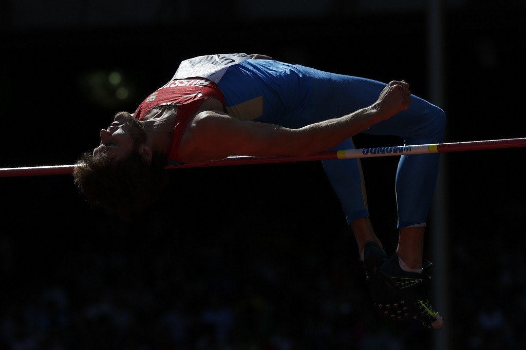 """Russia's Ivan Ukhov competes in the qualifying round of the men's high jump athletics event at the 2015 IAAF World Championships at the """"Bird's Nest"""" National Stadium in Beijing on August 28, 2015. AFP PHOTO / ADRIAN DENNIS"""