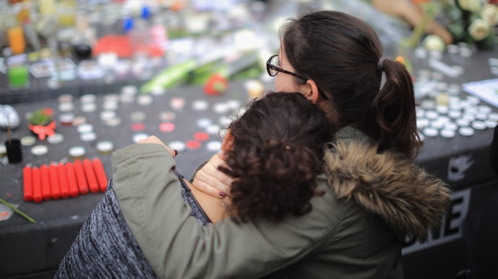People observe a minute-silence at the Place de la Republique in memory of the victims of the Paris terror attacks last Friday, on November 16, 2015 in Paris, France. Countries across Europe will join France, currently observing three days of national mourning, in a one minute-silence today in an expression of solidarity with the victims of the terrorist attacks, which left at least 129 people dead and hundreds more injured.