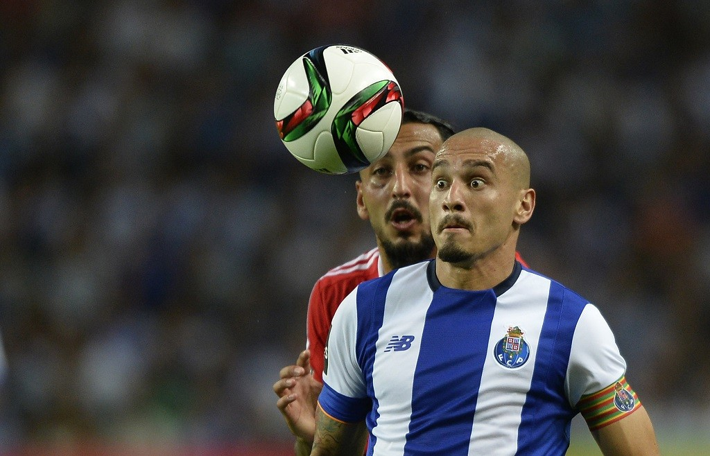 Porto's Brazilian defender Maicon (R) vies with Benfica's Greek forward Konstantinos Mitroglou during the Portuguese league football match FC Porto vs SL Benfica at the Dragao stadium in Porto, on September 20, 2015. Porto won the match 1-0.  AFP PHOTO/ MIGUEL RIOPA